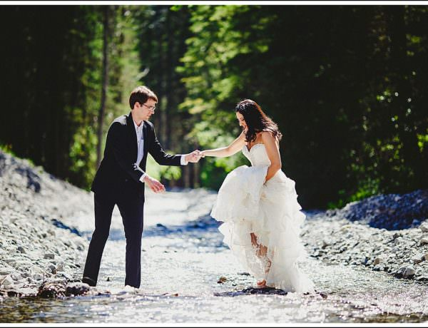 Bride and groom crossing small creek