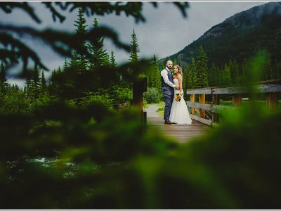 Formal portrait of bride and groom in the mountains