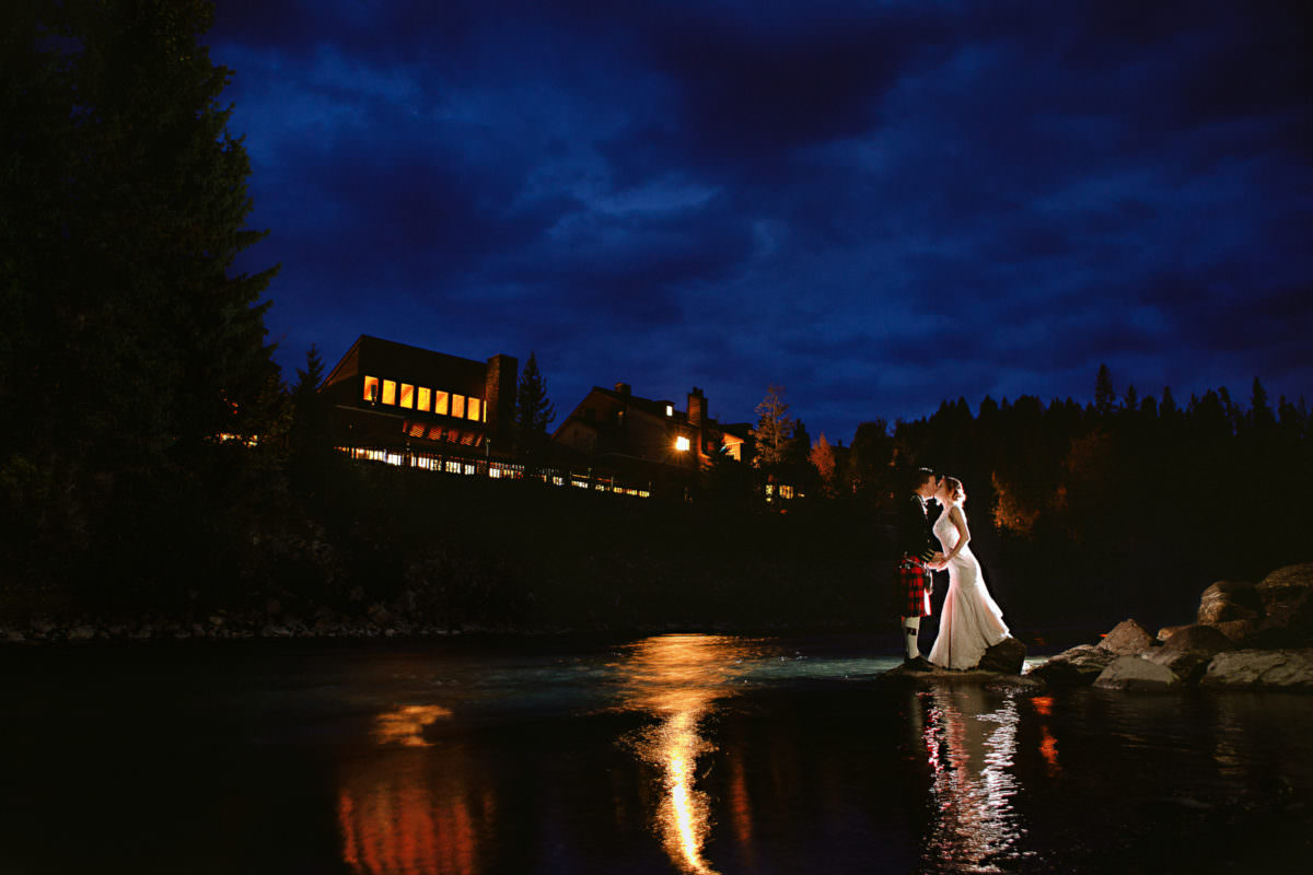 Dramatic nighttime portrait of bride and groom at Panorama Mountain Resort