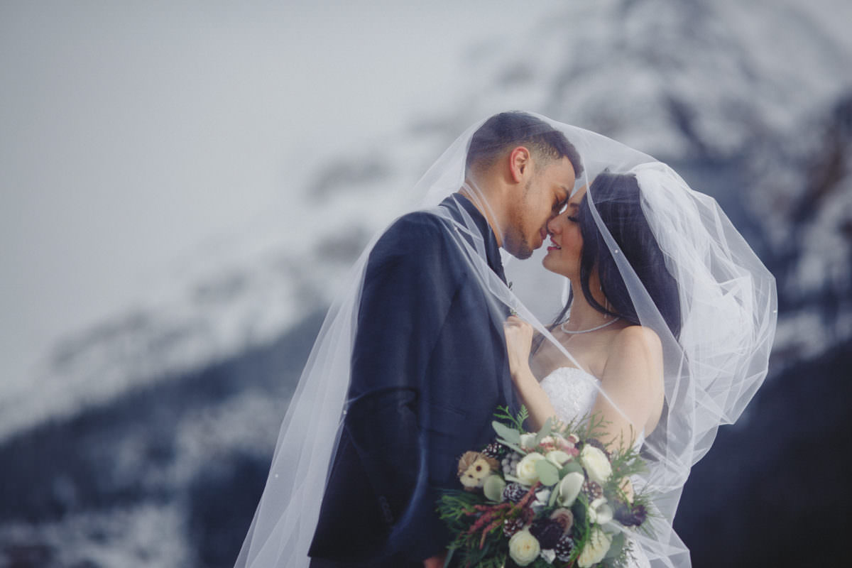 Bride and groom in snow at Chateau Lake Louise