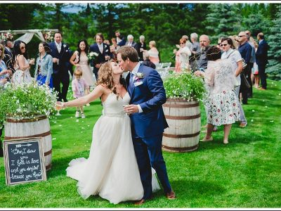 Bride and groom kissing at outdoor wedding
