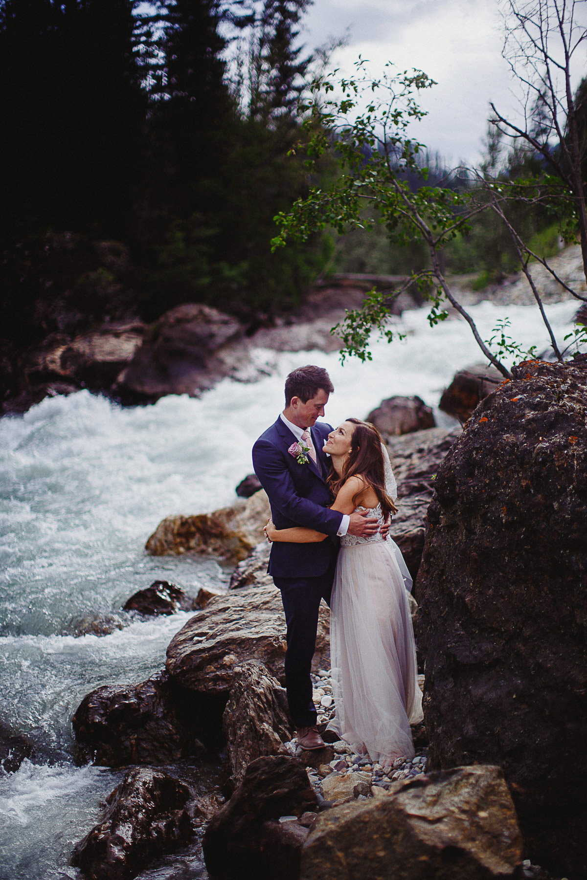 Adventurous wedding couple near Panorama Mountain Resort