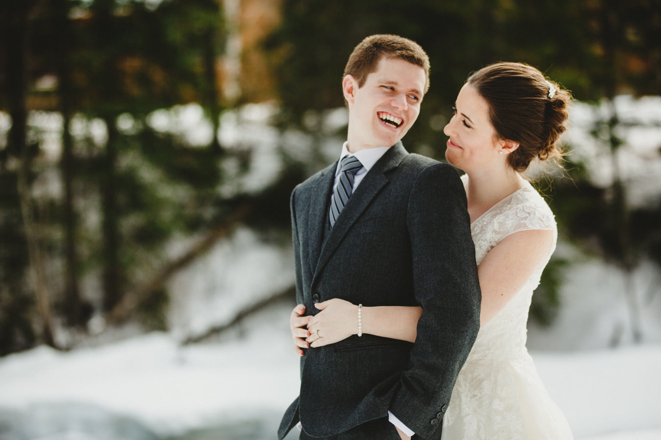 Bride and Groom enjoying snowy trees at Panorama Mountain Resort