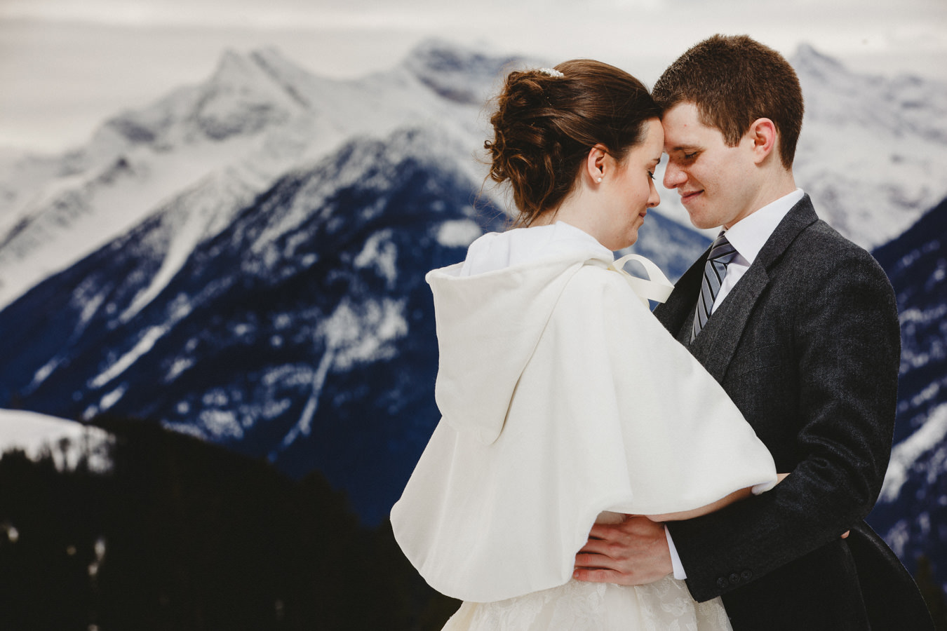 Bride and Groom with dramatic mountain backdrop at Panorama Ski Hill