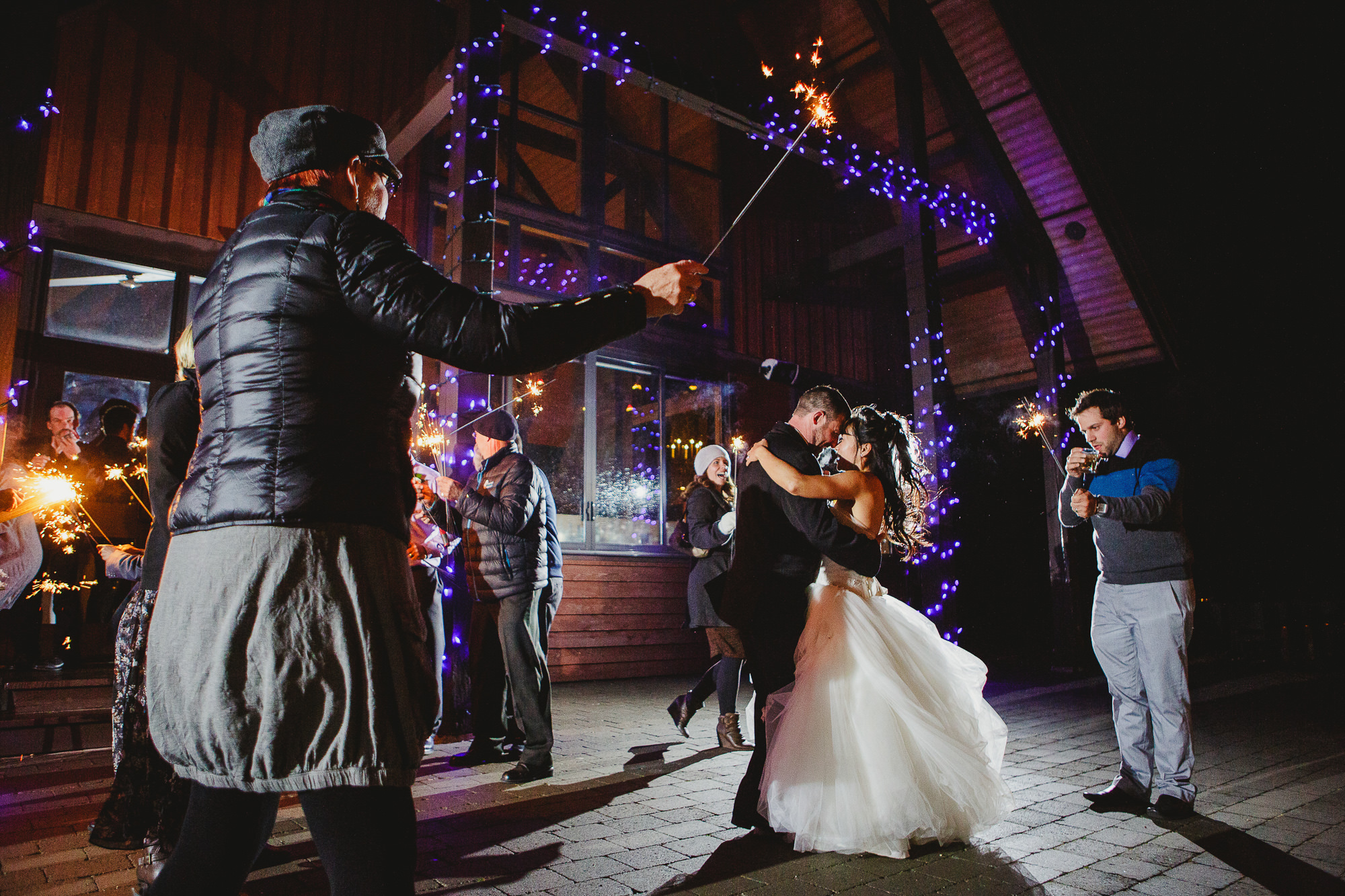 Bride and groom dancing on the terrace at Eagles Eye Restaurant at the top of Kicking Horse Mountain Resort