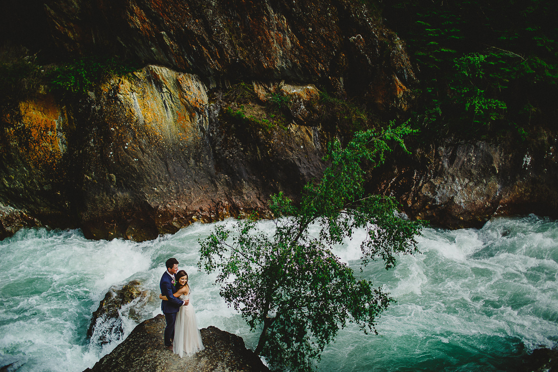Bride and groom near Toby Creek at Panorama Ski Hill