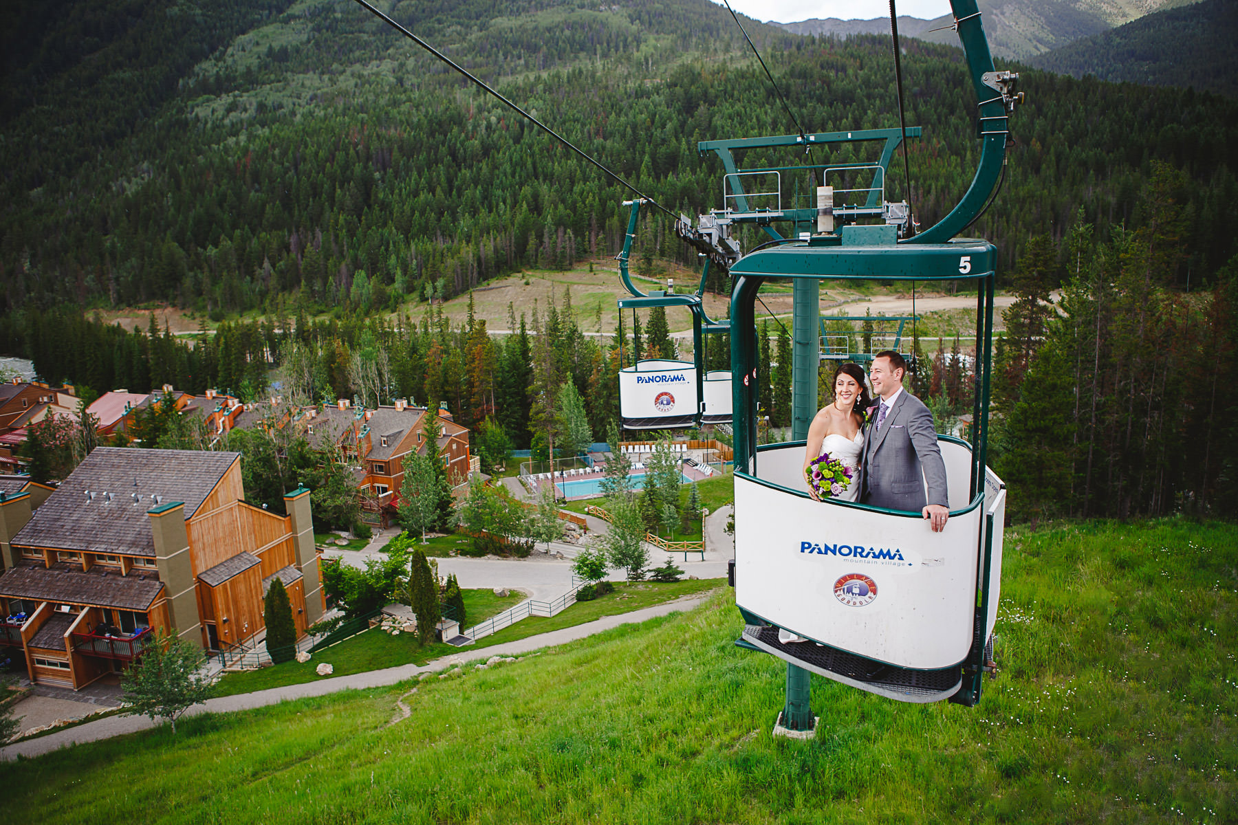 Bride and groom riding in gondola at Panorama Ski Hill