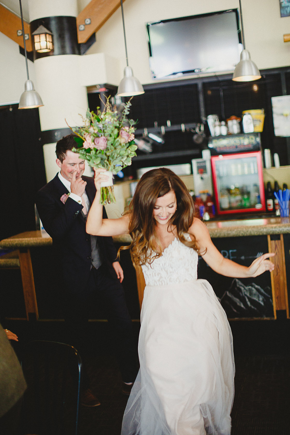 Bride joyfully enters reception at Panorama Mountain Resort