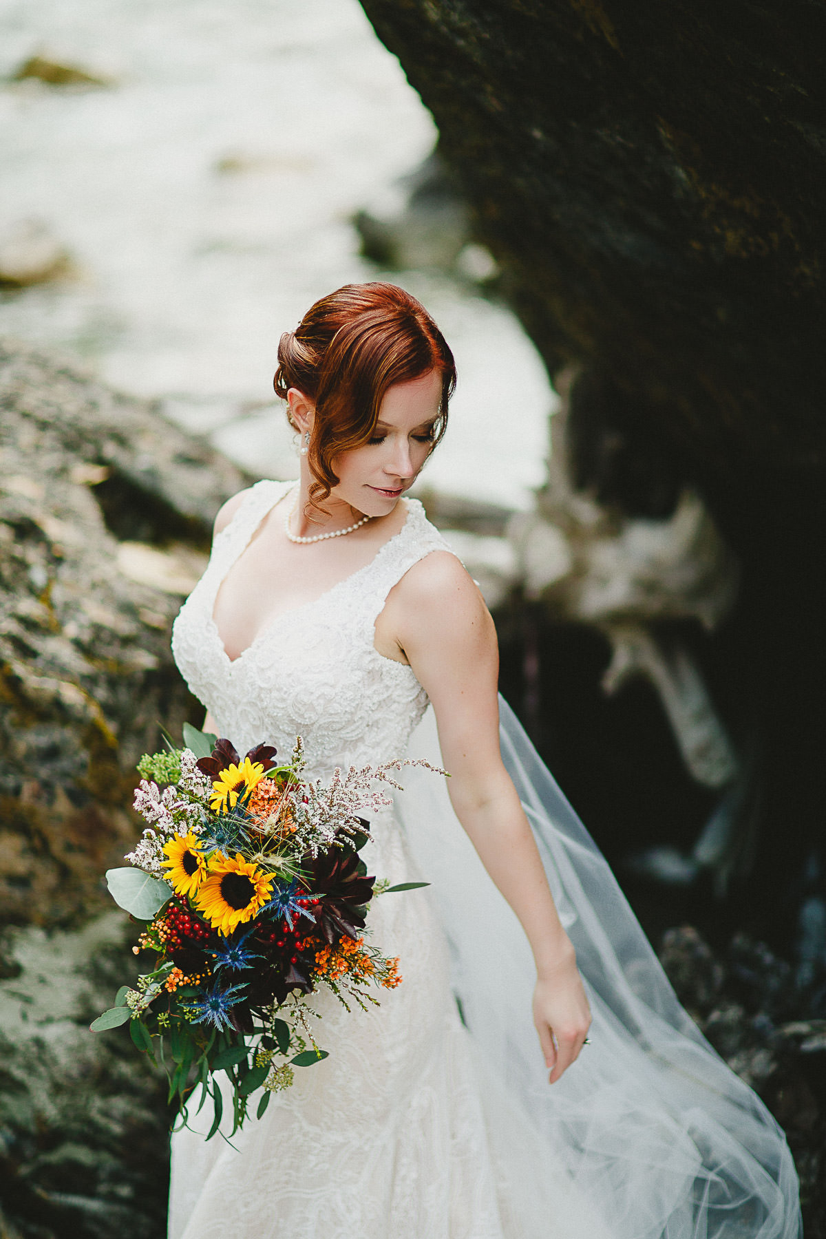 Bride posing near creek at Panorama Mountain Resort
