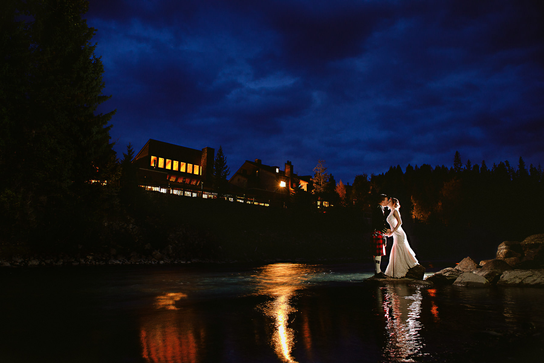 Dramatic nighttime portrait of wedding couple at Panorama ski hill