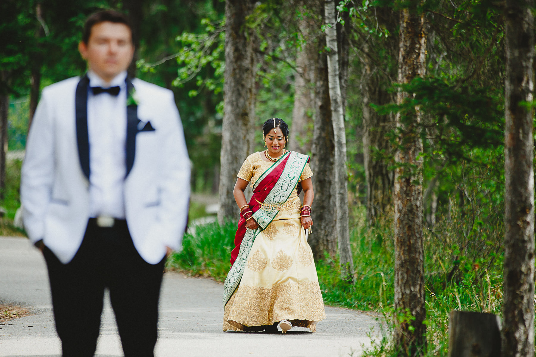 Groom waiting for his bride during the first look at Panorama Mountain Resort