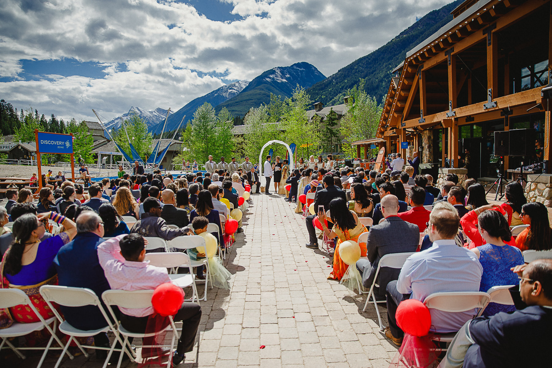 Wide angle of wedding ceremony on deck at Panorama Ski Hill