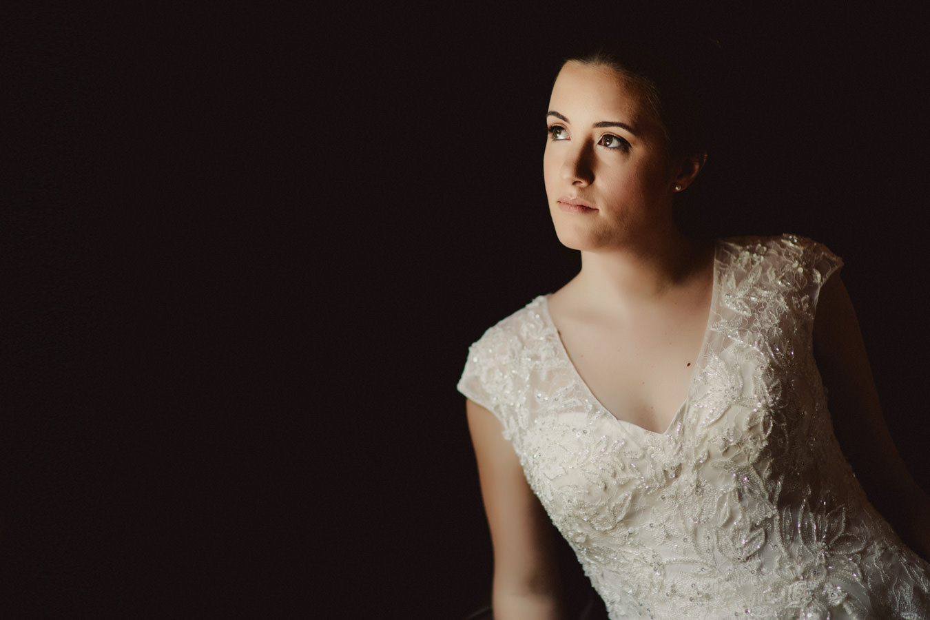 Window light portrait of bride at Panorma Ski Hill