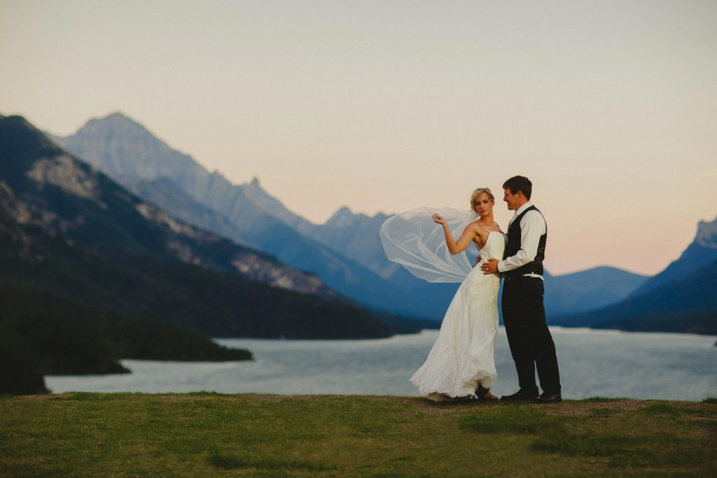Bride's veil gets caught in wind at Prince of Wales Hotel at Waterton AB