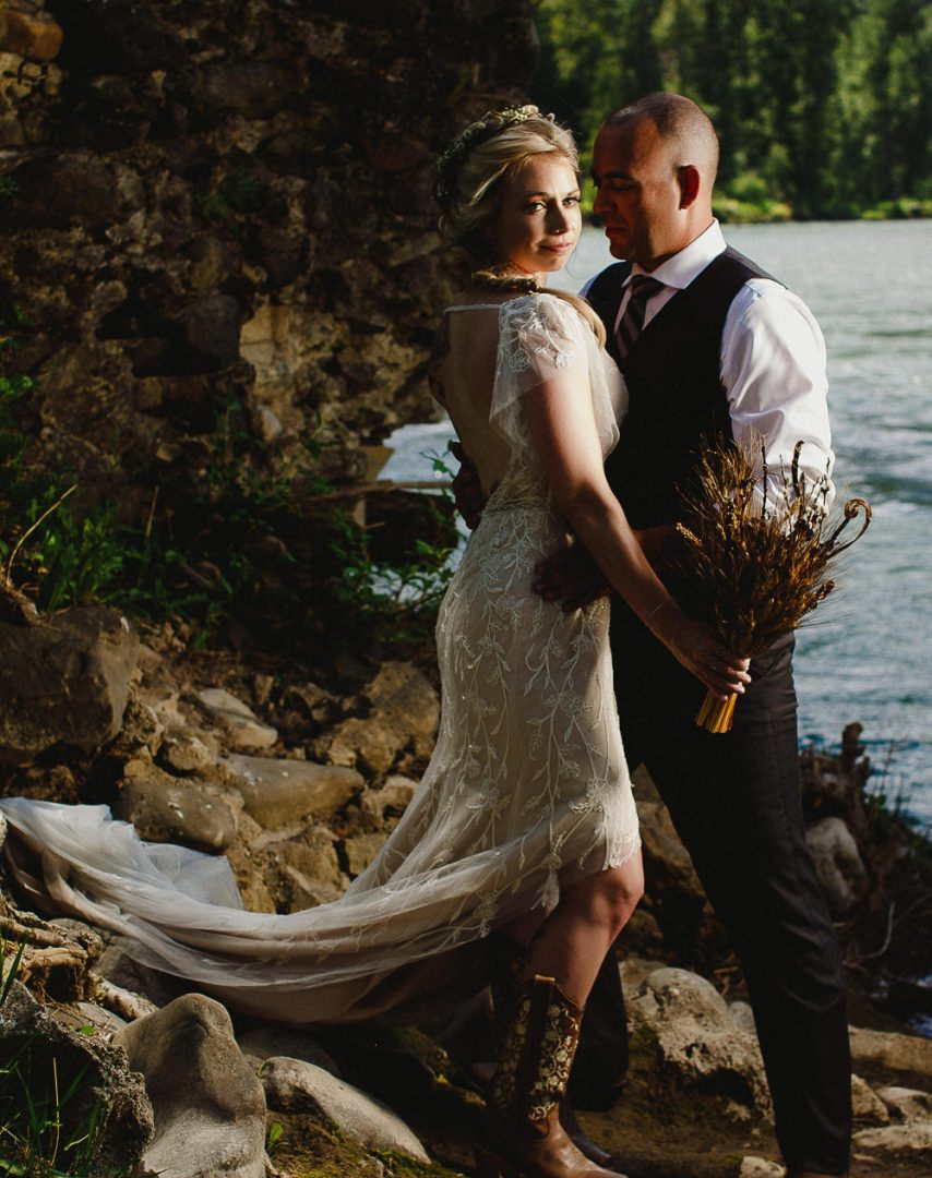 Tammy and Mark stand on their wedding day by the Elk River near the Elkview Lodge in Fernie