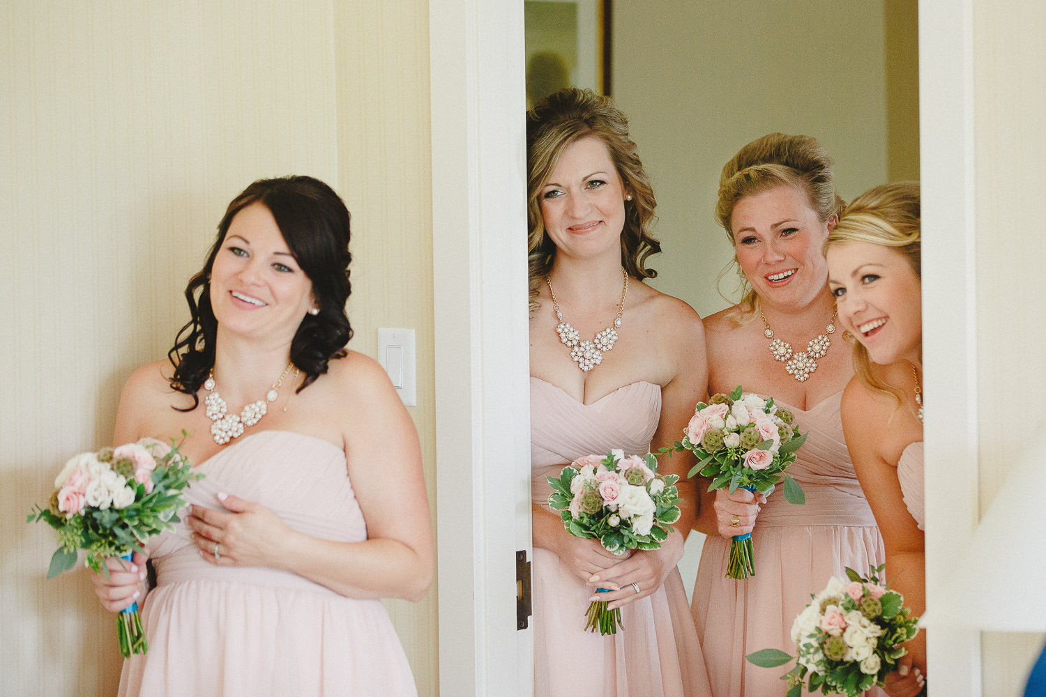 Bridesmaids react to seeing bride in dress
