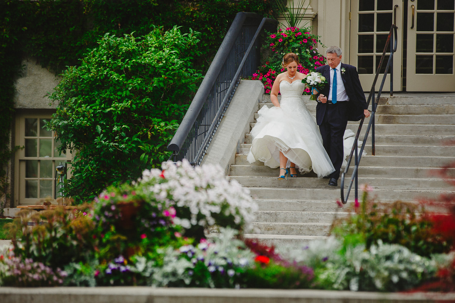 Bride and father descend St Eugene stairs for ceremony
