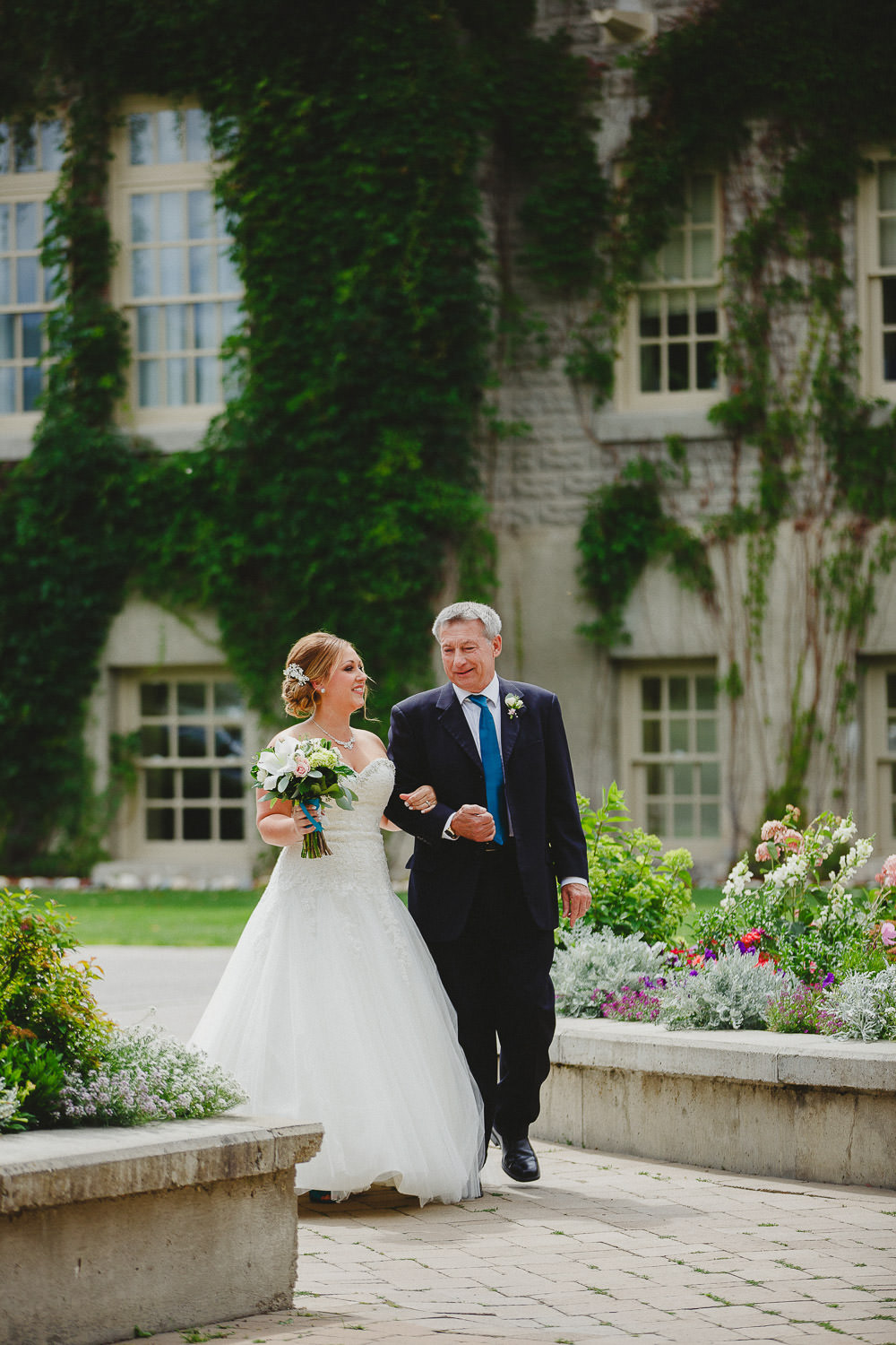Bride and father approach ceremony at St Eugene Resort