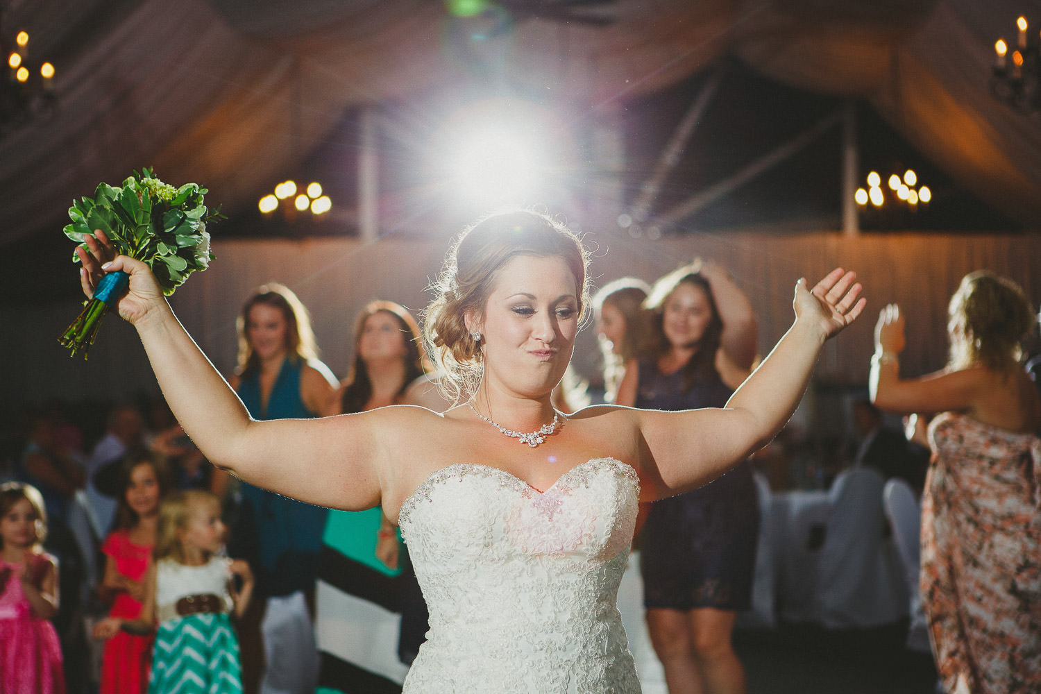 Bride prepares to throw bouquet at St Eugene Mission