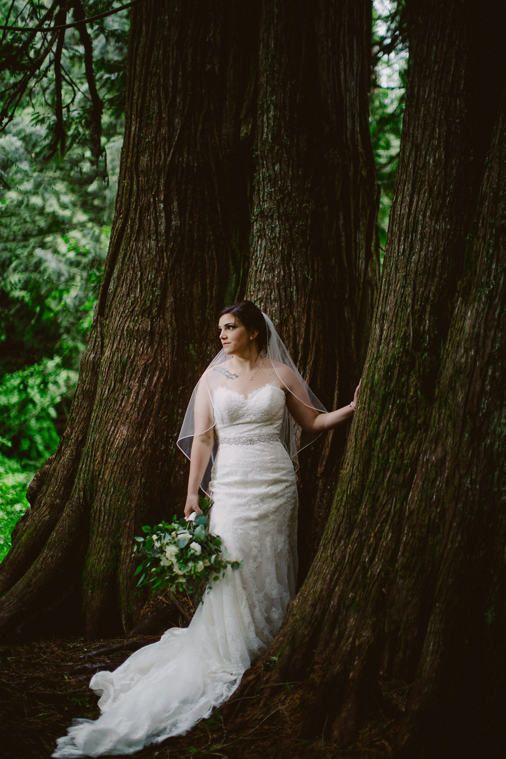 Bride holding bouquet in magical forest