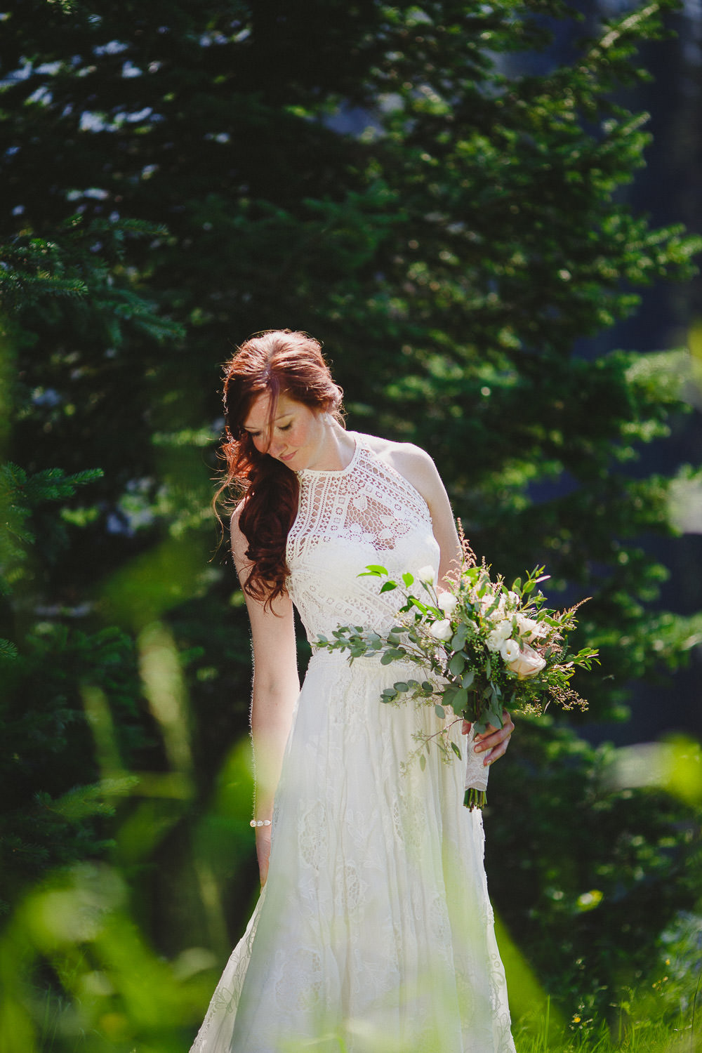 Boho bride holding bouquet
