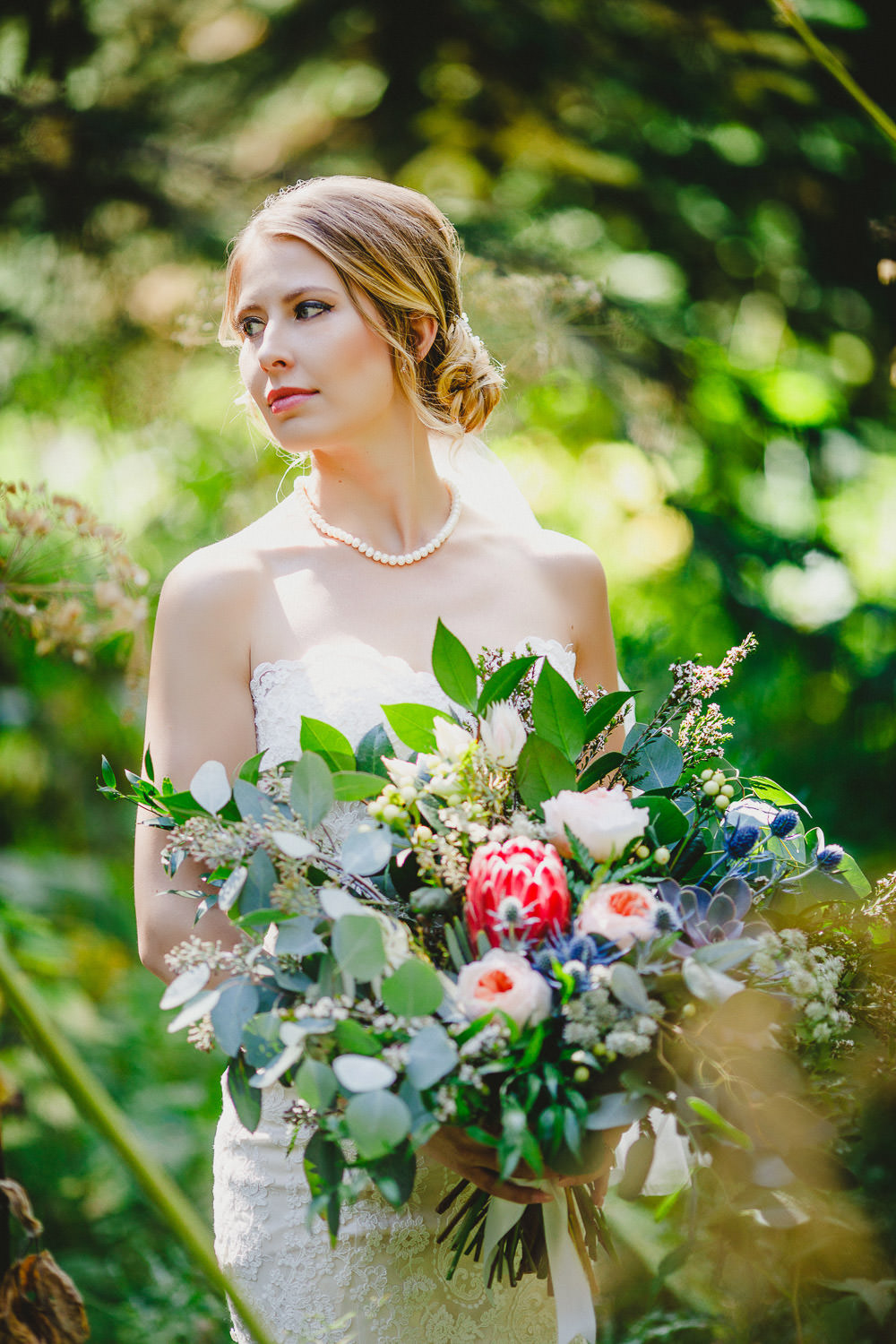 Bride holding bouquet from The Green Petal